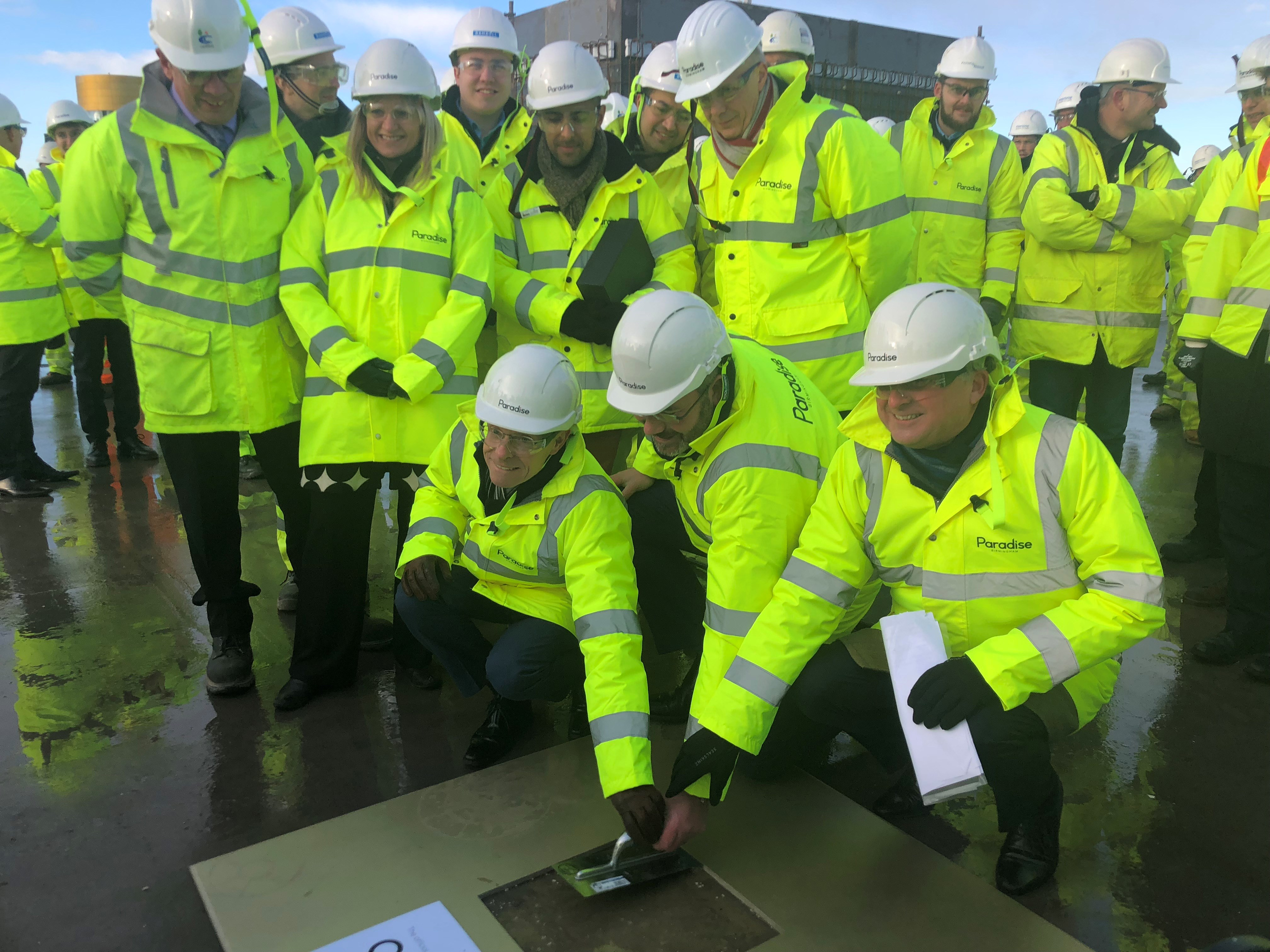 Mayor tops out first building at Paradise development